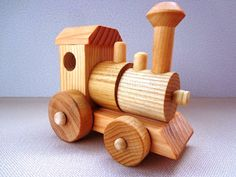 This classic wooden train set is made of all wood. Imagine your little one pushing this train around using their imagination to make all sorts of train sounds. Children will enjoy this toy for years and will pass this toy on to the next generation. Best part about this vintage style toy is No Batteries needed, just imagination and kid power! This train is all doweled together with absolutely no metal parts! It is hand crafted using hand selected stock, hand sanded completely smooth and then…