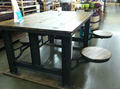 Cafeteria table from World Market. Could be cute on screened back porch.