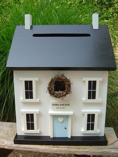 A card box shaped like a house! I can imagine making this out of a large copy box with some really cute papers.