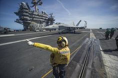 PHILIPPINE SEA (Aug. 22, 2013) Aviation Boatswain's Mate (Handling) 1st Class Katrina Vong, from Seattle, directs an F/A-18E Super Hornet from the Dambusters of Strike Fighter Squadron (VFA) 195 on the flight deck of the aircraft carrier USS George Washington (CVN 73).