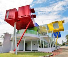 Shipping containers are sturdy, versatile structures that have traveled the world over the course of their lifespan. dpavilion architects designed the containers into a health clinic and public library.