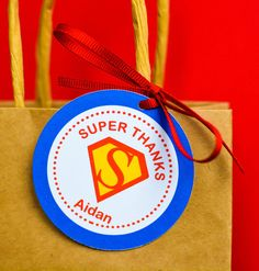 Add charm to your goodie bags, favors, or candy by tying these adorable personalized Superman tags around it. By 3 Trucks And A Tiara.