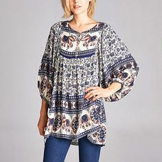 Black Elephant Peasant Tunic Puffed sleeves and a billowing bottom amp up comfort while exuding style in this modern boho-chic tunic.   *Cover photo is of the navy blue tunic. Tunic for sale is in the black.   ** These are loose fitting and because of that they can fit a size up.   1X can also fit a 2X.  2X can also fit a 3X.  3X can also fit a 4X.  It all depends on how loose fitting you prefer the fit. These do not run small.   Size 1X: 34'' long from high point of shoulder to hem 100%…