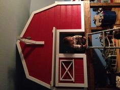 A barn loft bed, both boys each have a toddler mattress inside. Created so much extra floor space!!