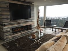 Napoleon's Linear fireplace with TV above. Awesome view of LA Fireplace Feature Wall, Tv Above Fireplace, Linear Fireplace, Fireplace Hearth, Fireplace Inserts, Modern Fireplace, Living Room With Fireplace, Fireplace Design, Fireplace Ideas