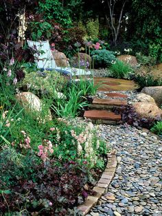Meandering Soft Pebble Pathway A soft pebble pathway is retained by using a brick edging for support. Soft surfacing for garden pathways consists of natural materials that include combinations of stone, wood and shell.