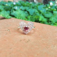 Handmade Sterling Silver floral heart with natural Rhodolite Garnet set with Rose Gold claws. Size M (Australian) Handmade Sterling Silver, Claws, Garnet, Heart Ring, Handmade Jewelry, Rose Gold, Natural, Rings, Floral