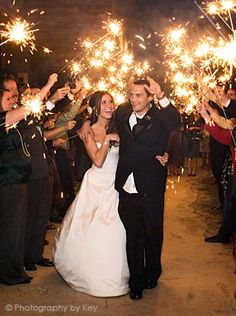 "Sparklers! Love this idea after being announced ""Husband and Wife"""