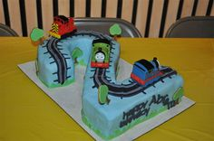 Thomas the Train Cake!! Like this too maybe use cupcake in shape of number 2