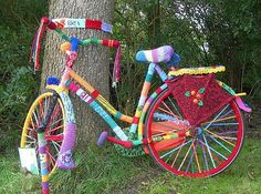 """""""yarn bombing (or yarn storming), a form of graffiti that involves covering objects in public spaces with knitted, woven, or crocheted yarn cozies."""""""