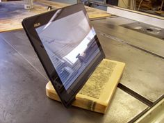 Perhaps sacrilegious, but here's a tablet stand made from a book.   Makezine.como
