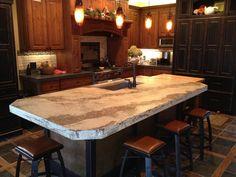 Gorgeous Pendant Lamps Above Concrete Kitchen Island Countertop Plus Wooden Kitchen Cabinets Design