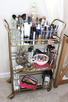 A bar cart for stylish makeup storage...keeps your work space clear of clutter. This bar car is from World Market. #makeupstorage #makeuporganization #barcart
