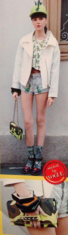 P. 36 of Vogue Italia's summer 2014 shopping guide. Top and printed shorts, Au Jour Le Jour; hat, Piers Atkinson; resin bracelets, Angela Caputi Giuggiù; camo shoulder bag, Valentino Garavani; socks, Calzedonia; sandals, Aquilano.Rimondi; jacket, Chiodi Peuterey Aiguille Noire.