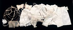 Blondinette's Undergarments    Comprising two white cotton chemises,two petticoats,one pantalets,wired hoop,muslin sous-sleeves,cap,face veil,and a silk corset with yellow silk threads. Each piece features delicate hand- stitching. Near mint condition. Circa 1863.