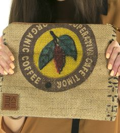 Coban Foldover Coffee Sack Clutch by Bare.  Handcrafted from a recycled brown burlap coffee sack with charcoal grey waxed canvas back and lining.