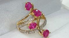 Online veilinghuis Catawiki: Gouden ring met robijnen en diamanten.