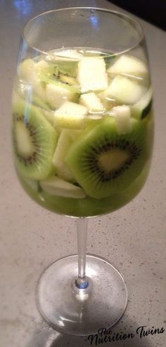 Skinny Green Sangria   ONLY 101 CALORIES   Celebrate and LOSE WEIGHT!   YAY, a cocktail that won't pack on the pounds  #cocktail #skinny #weightloss   For MORE RECIPES like this please SIGN UP for our FREE newsletter www.NutritionTwins.com