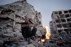 Palestinian Ziad Rizk, 38, makes coffee next to one of the destroyed Nada Towers, where he lost his apartment and clothes shop, in the town of Beit Lahiya, northern Gaza Strip, on Aug. 11.