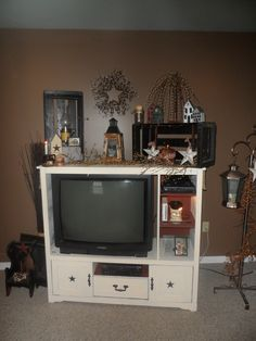 My diy entertainment center and primitive decorations primitive country homes, primitive crafts, country farmhouse Primitive Country Homes, Primitive Crafts, Primitive Decorations, Prim Decor, Primitive Furniture, Rustic Decor, My Living Room, Living Room Decor, Entertainment Center Makeover