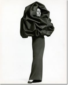 "Cristobal Balenciaga. House photograph of evening ensemble; dress of black silk crepe and ""chou"" wrap of black silk gazar, winter 1967."
