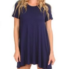 Navy T-shirt Dress Loose, flowy dress combines the classic style of a T-shirt with the fashionable cut of a babydoll dress  * Stretch knit shirt dress * Straight, thigh-length hem * 95% rayon, 5% spandex Dresses Mini