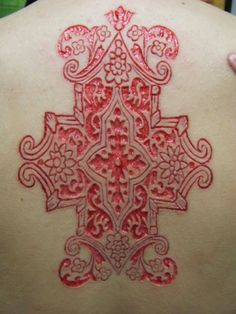 Scarification... to each their own I say.... Ouch! But nice design... Would have been better as a tattoo