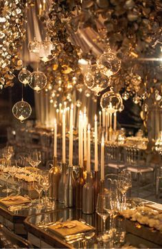 "Candlelight - magical. Similar hanging ""clear Tealight Teardrop"" candle holders available at www.selecthomeaccents.com"