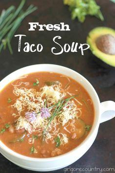 Fresh Taco Soup made with fresh tomatoes, fresh beans, broth, veggies, chili powder, garlic, onions and ground turkey.