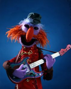 Floyd Pepper from ''The Muppet Show'' Sesame Street Muppets, Sesame Street Characters, Cartoon Characters, Die Muppets, Bass Guitars For Sale, Heroes Wiki, Muppets Most Wanted, Bass Guitar Lessons, Fraggle Rock