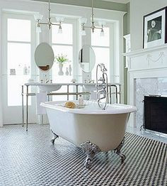 so awesome, both very modern and very traditional victorian yet also clinical.. interesting bathroom