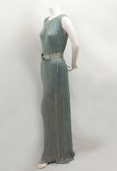 Fortuny Delphos tea gown, 1930s. . . . The matching twisted silk belt is stenciled with silver ginkgo leaves.