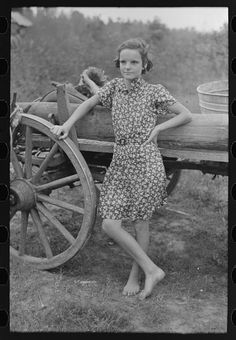 Farm girl leaning on wagon, near Morganza, Louisiana. Nov. 1938.  Lee, Russell, photographer.