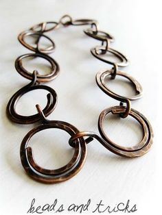 I would like to make something like this with leather rings/spirals and copper joining wrings. Would be cool with combo of leather/copper in one spiral, too. This artist has a neat way of joining the elements--clever and natural. LOVE