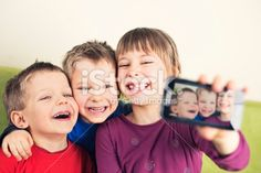 Kids taking photo with mobile phone Royalty Free Stock Photo With coupon codes and promotional codes.
