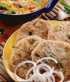 Jowar rotis flavoured with spring onions and green chilli.