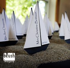 i love this! so adorable! boats to tell guests their table number. i would use brighter colors though