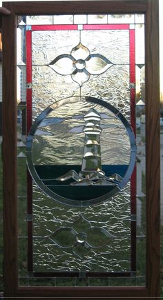 Stained Glass Lighthouse Window made by artist Kim P. Kostuch