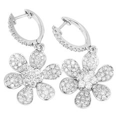 Amazing White Gold and Diamond Flower Dangle Earrings   From a unique collection of vintage dangle earrings at https://www.1stdibs.com/jewelry/earrings/dangle-earrings/