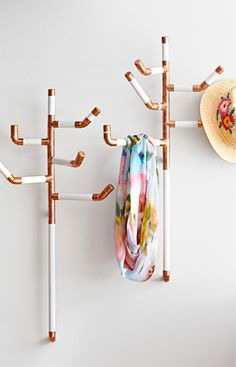 These coat trees look like they were inspired by real trees. Turn copper parts and painted dowels into a handy hanger for your entryway or mudroom.