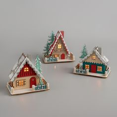 Add old& charm to your holiday with our cheerful Nordic& houses, accented with snowy roofs and backyard trees. Intricately crafted of laser& wood and outfitted with LED bulbs, they illuminate with the flip of a switch to give off a cozy glow. Gingerbread Christmas Decor, Christmas Garden, Christmas Wood, Retro Christmas, Simple Christmas, Winter Christmas, Christmas Market Stall, Christmas Village Houses, Christmas Villages