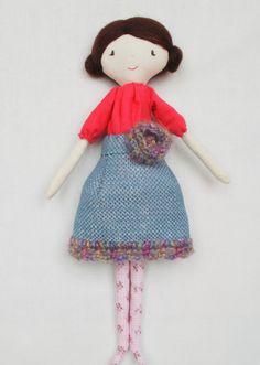 Handmade rag doll with big flower
