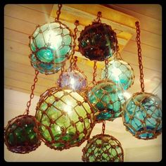 Old glass buoys turned into a chandelier.  Fabulous =)