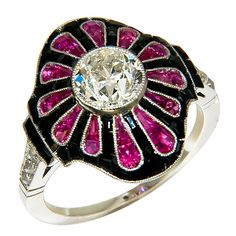Art Deco Diamond, Ruby and Platinum Ring set with an old European cut.