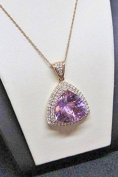 12 Carat Trillian Rose de France Pendant surrounded by a double halo of .80 Carats of round Diamonds in 14K Rose Gold   #finejewelry #pendant #rosegold #14K  #diamonds #diamondsontheplaza #necklace #jewelry #uniquejewelry #frankreubel #alexreubel #finejewelry #rosedefrance #amethyst #semiprecious #gemstones #purplesstones #trillian