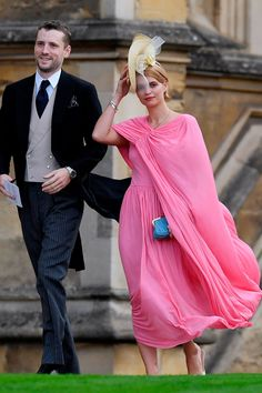 British model and singer Pixie Geldof made a statement in bright pink cape dress. She was joined by her husband George Barnett, drummer of These New Puritans. Princess Eugenie Jack Brooksbank, Princess Eugenie And Beatrice, Pixie Geldof, Wedding Dress Petticoat, Eugenie Wedding, Wedding Guest Looks, Vogue Wedding, Pink Gowns, Glamour