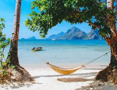 Hammock on Las Cabanas beach El Nido, Palawan Philippines