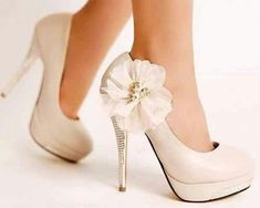 Speaking my love language with these flowered white pearl high heels #weddingshoes
