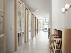 This Japanese 'shaire' salon mixes co-working with hair styling - News - Frameweb Staff Lounge, Plywood Table, Oak Plywood, Office Waiting Rooms, Coffee Room, Workplace Design, Co Working, Coworking Space, Chairs For Sale