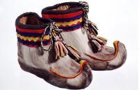 Nutukkaat - Fur shoes, sámi people don't use socks at all in these winter shoes, but only softed hay Finland